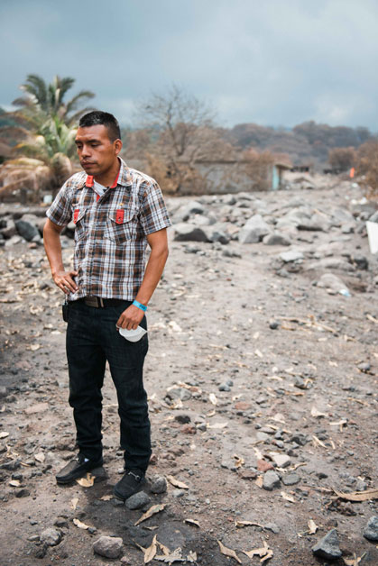 Julio Morazan stands at Ground Zero where his house once stood. The volcano took the lives of 12 of his family members.