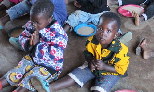 Children Praying In Malawi