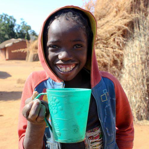 Zambian girl drinking water