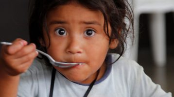 Child eating with a spoon