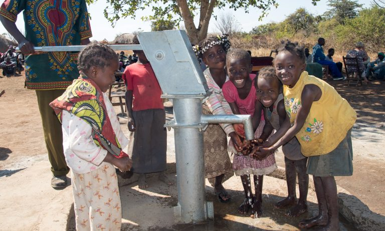 Kids at water well