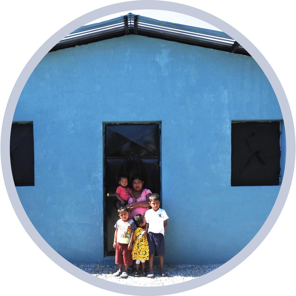 Woman and children standing in a doorway