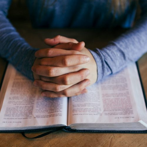 Reading the bible and praying