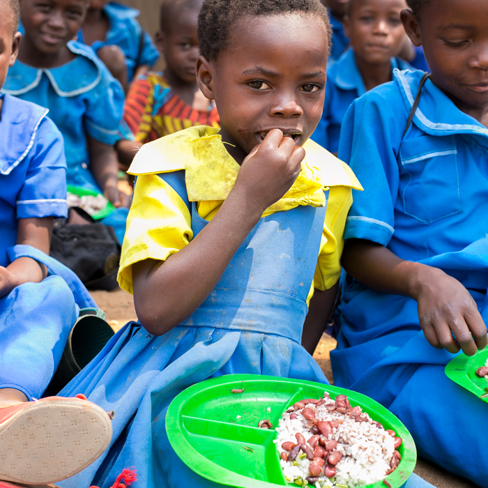 Malawian girl eating lunch at school