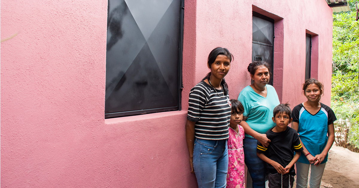 Mailyn Najera and her family in front of their new home