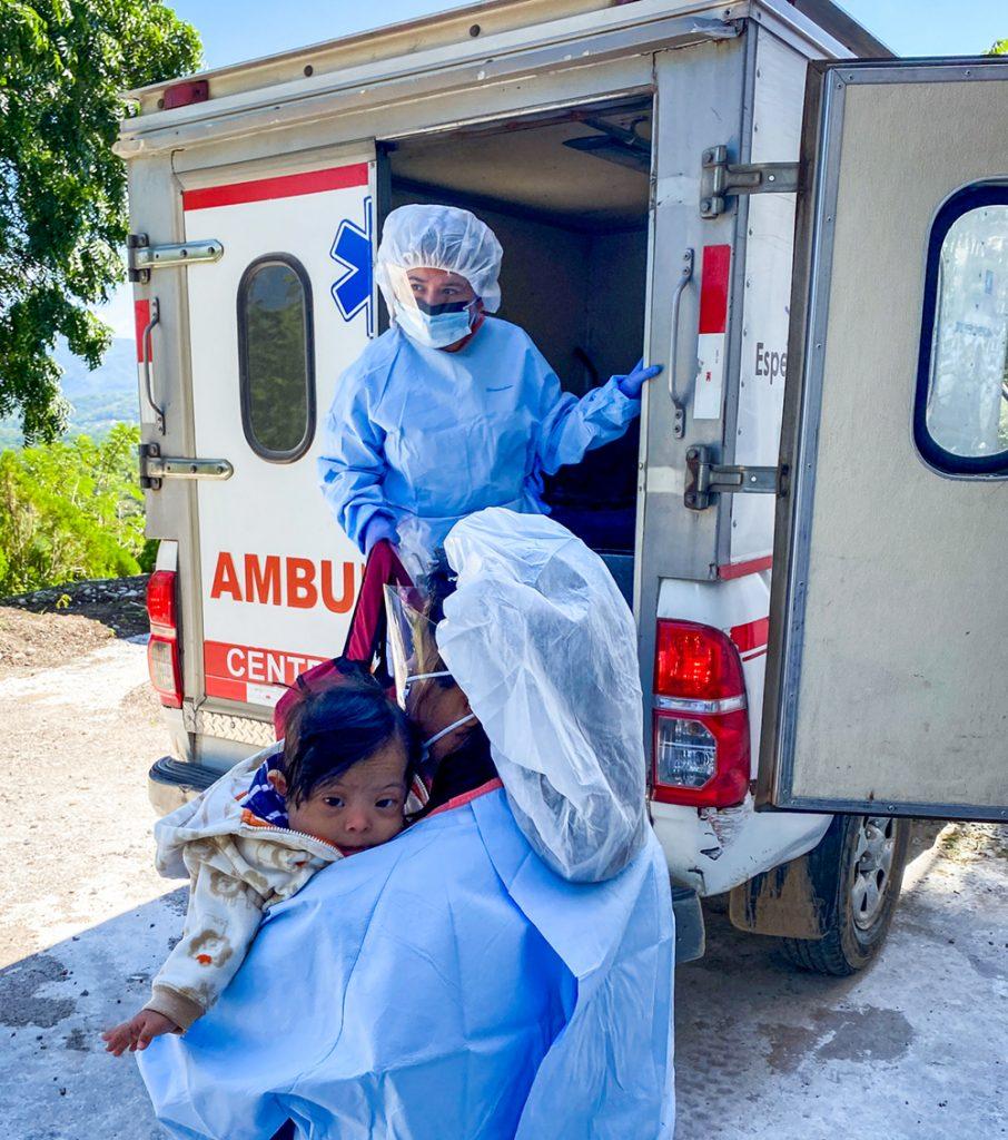 Child rescue team taking Melani to the ambulance