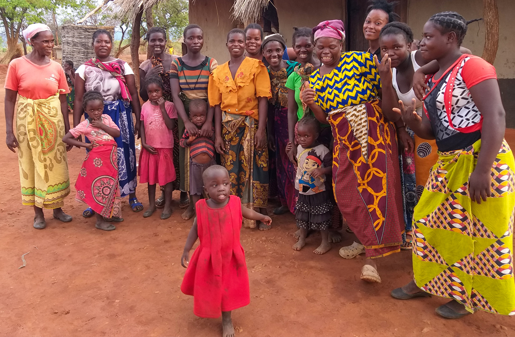 Ireen celebrating with other women in the Kamiza Village