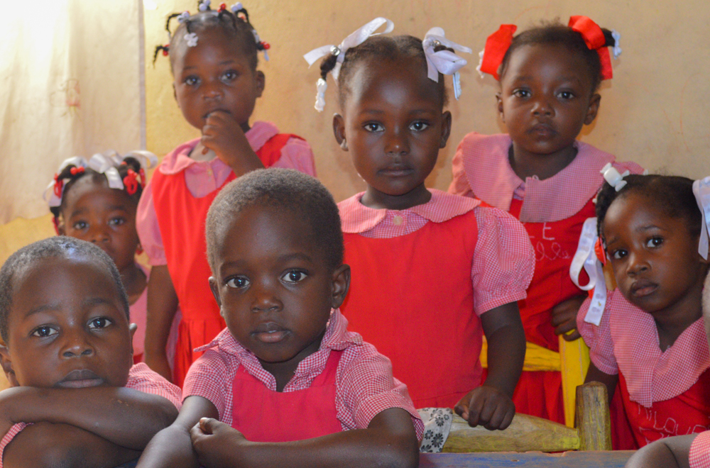 Haitian children in school looking at the camera