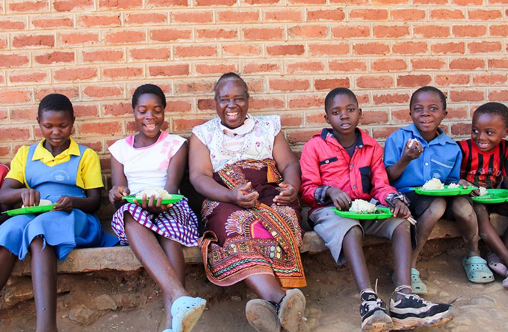 Kids with school support program leader