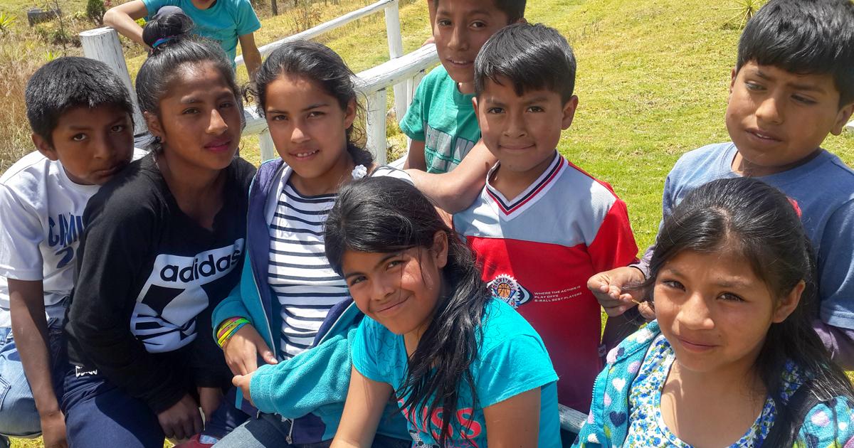 Group of ecuadorian kids smiling at the camera
