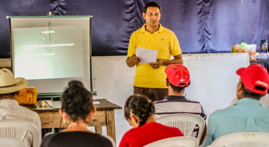 Victorino leading a community development training session